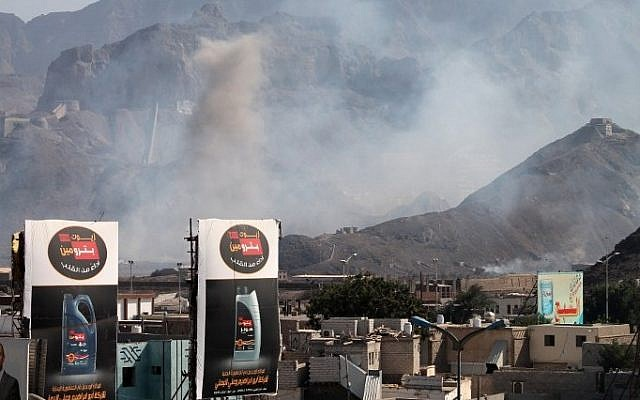Smoke billows from the site of an explosion that hit an arms depot in Yemen's second city of Aden on March 28, 2015. (photo credit: AFP/SALEH AL-OBEIDI)