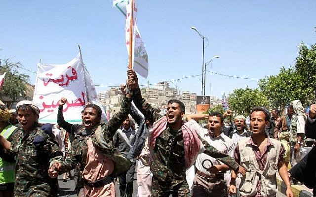 Yemeni Shiite Houthi rebels and supporters take part in a demonstration in the southwestern city of Taez against the Saudi-led military intervention in the country, on March 29, 2015. (photo credit: AFP/STR)