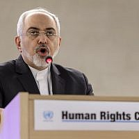 Iranian Foreign Minister Mohammad Javad Zarif delivers a speech  at the opening day of UN Human Rights council session at the United Nations offices in Geneva on March 2, 2015. (AFP/FABRICE COFFRINI)