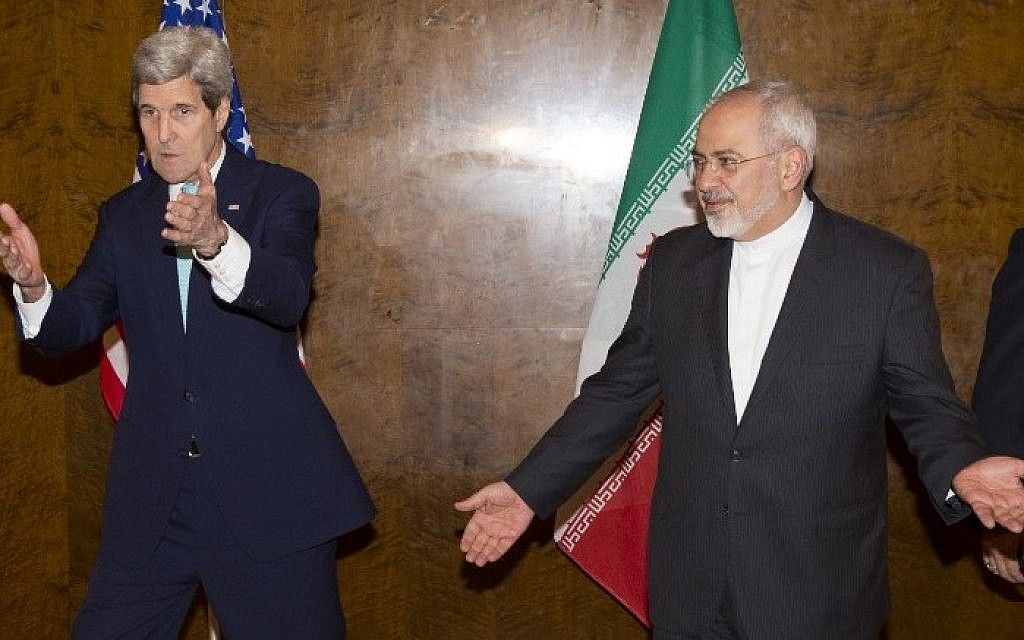 US Secretary of State John Kerry, left, and Iranian Foreign Minister Mohammad Javad Zarif prepare to take their seats for a new round of nuclear negotiations in Montreux, Switzerland, on March 2, 2015.  (photo credit: AFP/POOL /EVAN VUCCI)