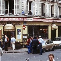 This file picture dated August 11, 1982, shows people standing in front of the Chez Jo Goldenberg restaurant in Paris, two days after it was devastated in an attack by Palestinian gunmen (AFP/ JOEL ROBINE)