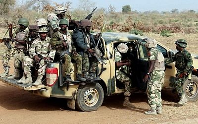 IIllustrative photo of Nigerian army soldiers on patrol on March 5, 2015. (Photo credit: AFP/SUNDAY AGHAEZE)
