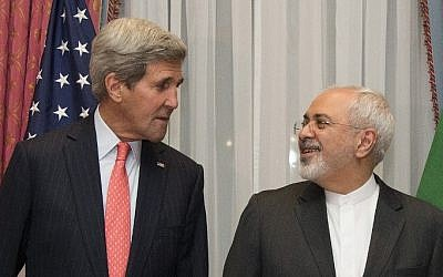 US Secretary of State John Kerry (L) and his Iranian counterpart, Mohammad Javad Zarif, pose before resuming talks over Iran's nuclear program in Lausanne on March 16, 2015 (photo credit: AFP/POOL/BRIAN SNYDER)