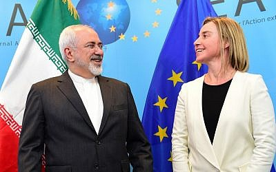 Iranian Foreign Minister Mohammad Javad Zarif, left, is welcomed by EU foreign policy chief Federica Mogherini on March 16, 2015 at the European External Action service headquarters in Brussels.(photo credit: AFP/ EMMANUEL DUNAND)