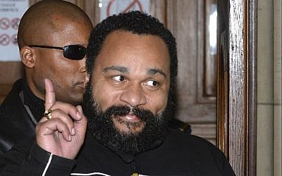 French comedian Dieudonne gesturing as he leaves his trial at the courthouse in Paris, France, February 4, 2015. (photo credit: AFP/Miguel Medina, File)