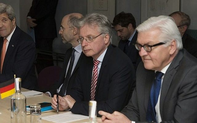 US Secretary of State John Kerry (L) and German Foreign Minister Frank Walter Steinmeier (R) attend a meeting in London about the recently concluded round of negotiations with Iran over their nuclear program, on March 21, 2015 (Photo credit: AFP/Pool/Brian Snyder