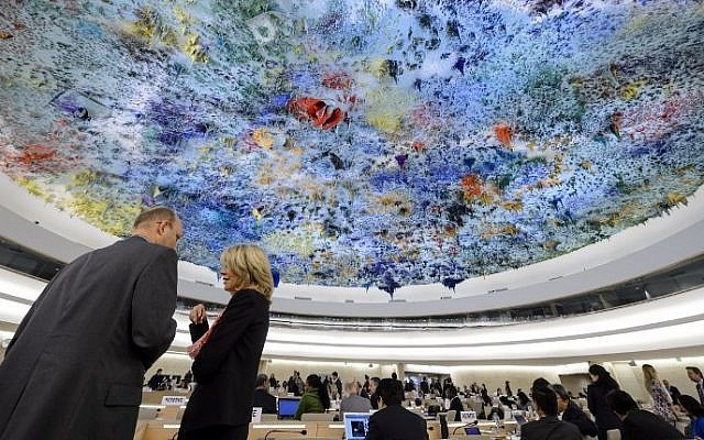 File: Delegates speak prior to the opening of a session of the Human Right Council on March 23, 2015 in Geneva. (Fabrice Coffrini/AFP/)