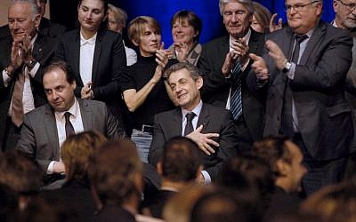 Former French president Nicolas Sarkozy, right, and President of the center-right party UDI Jean-Christophe Lagarde are seen during a meeting ahead of the second round of local elections in Perpignan, on March 26, 2015. (photo credit: AFP/RAYMOND ROIG)