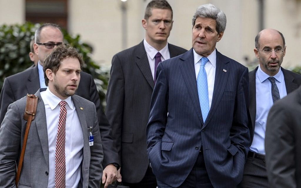 US Secretary of State John Kerry (2nd R) walks on March 29, 2015 with staff and security after a break in nuclear talks in Lausanne. Global powers are seeking to pin down the broad outlines of a deal to rein in Iran's suspect nuclear program by a March 31 deadline. (photo credit: AFP PHOTO / FABRICE COFFRINI)