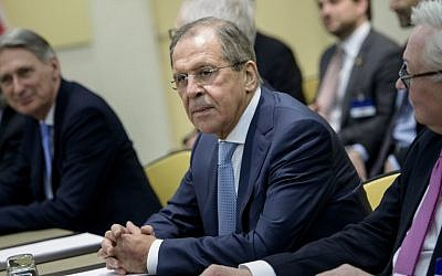 Russian Foreign Minister Sergey Lavrov (center) and others wait for a P5+1 meeting at the Beau-Rivage Palace Hotel in Lausanne, Switzerland, on March 28, 2015. (photo credit: AFP/Brendan Smialowski, Pool)