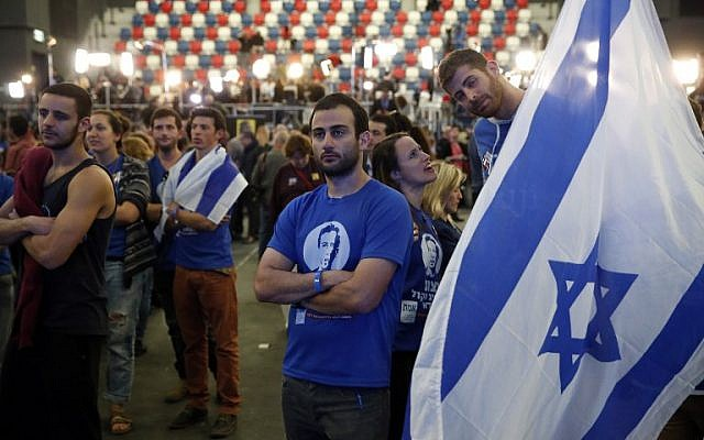 Israeli supporters of the Zionist Union party react to exit poll figures outside the party's headquarters on March 17, 2015 in the city of Tel Aviv. (photo credit: AFP/THOMAS COEX)