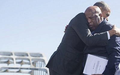 US President Barack Obama, right, hugs US Representative John Lewis,  one of the original marchers at Selma, during an event marking the 50th Anniversary of the Selma to Montgomery civil rights marches at the Edmund Pettus Bridge in Selma, Alabama, March 7, 2015. photo credit: AFP PHOTO / SAUL LOEB)
