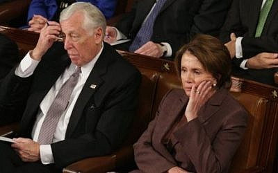 House Minority Leader Nancy Pelosi (R) and House Minority Whip Steny Hoyer (L) listen to Prime Minister Benjamin Netanyahu speak about Iran during a joint meeting of the United States Congress in the House chamber at the US Capitol March 3, 2015 (Chip Somodevilla/Getty Images/AFP)