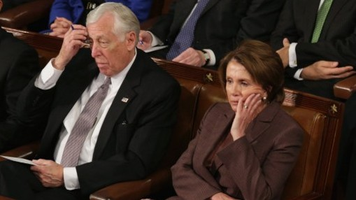 House Minority Leader Nancy Pelosi (R) and House Minority Whip Steny Hoyer (L) listen to Prime Minister Benjamin Netanyahu speak about Iran during a joint meeting of the United States Congress in the House chamber at the US Capitol March 3, 2015 (Photo credit: Chip Somodevilla/Getty Images/AFP)