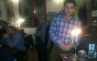 Jerusalem deputy mayor Ofer Berkovitch lights Hanukkah candles at Tmol Shilshom, December 2014. (Courtesy)