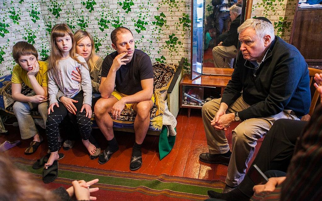 Head of Boston's Combined Jewish Philanthropies Barry Shrage (far right) with a family of Internally Displaced Persons in Dnepropetrovsk, Ukraine during a March trip there. (Courtesy CJP)