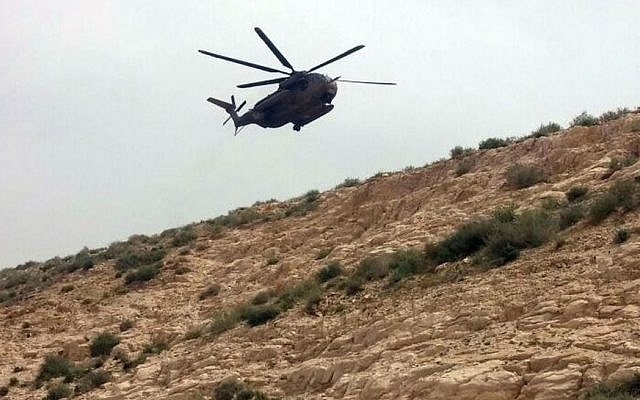 An IDF helicopter called out to assist in the recovery of a woman who fell to her death in Wadi Qelt, near Jerusalem, March 28. (MDA)