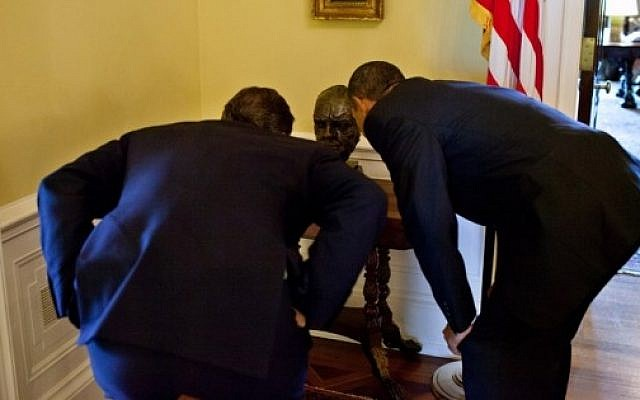 Illustrative photo: US President Barack Obama shows British Prime Minister David Cameron a bust of Sir Winston Churchill in the private residence of the White House,on  July 20, 2010. House speaker John Boehner is expected to give Prime Minister Benjamin Netanyahu a bust of Churchill as a gift on Tuesday. (photo credit: White House/Pete Souza)