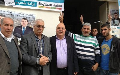 Volunteers for the Joint (Arab) List stand outside the local headquarters in the Arab city of Umm al-Fahm, March 17, 2015 (photo credit: Elhanan Miller/Times of Israel)