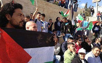 Palestinian demonstrators mark Land Day outside Damascus Gate in East Jerusalem, March 30, 2015 (photo credit: Elhanan Miller/Times of Israel)