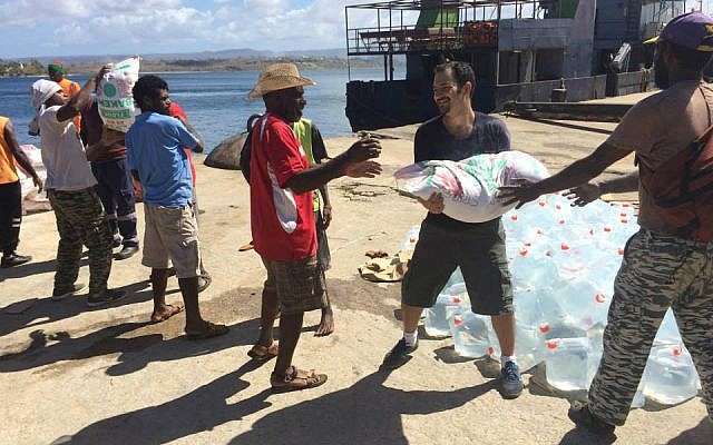 IsraAid volunteers helping locals on the cyclone-battered island-nation of Vanuatu, March 2011 (photo credit: courtesy)