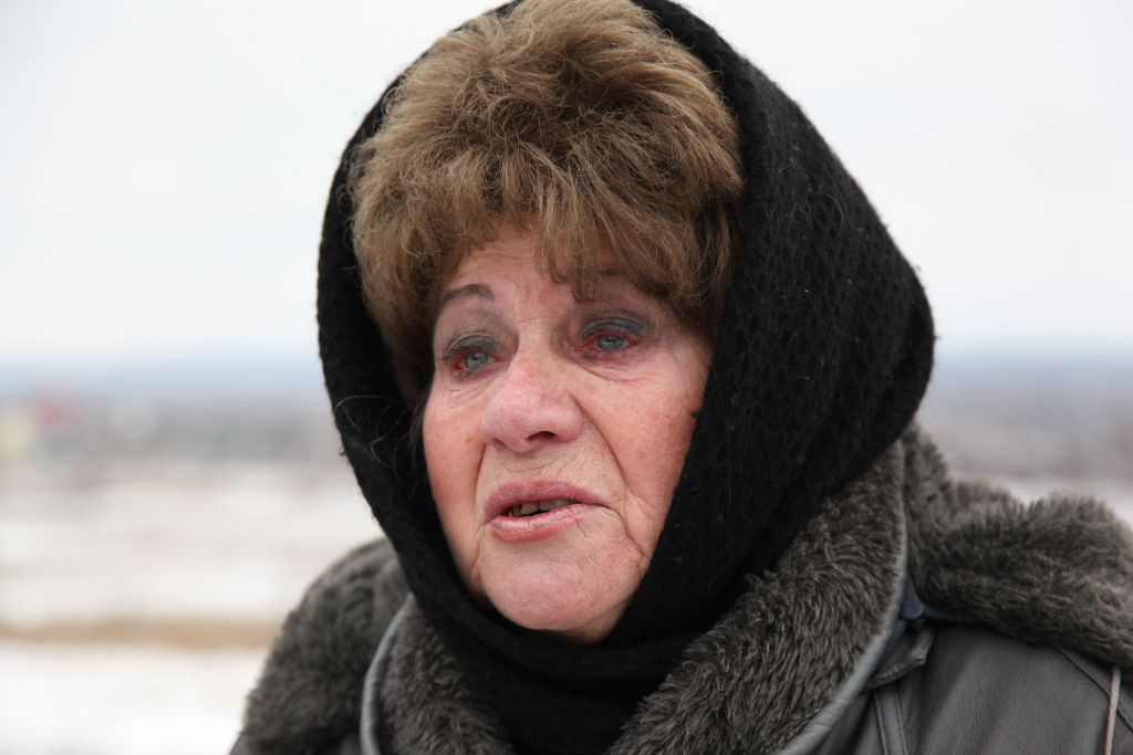 Recent widow Anna Kushnir, 76, from Slavyansk said she is not ready to leave her husband and will stay in Ukraine. (courtesy JDC)