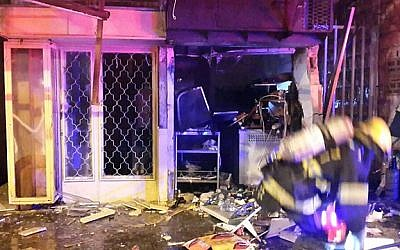 The destroyed store on Hehalutz Street in Haifa. Police suspect a man tried to burn down a competitor's store, but the fire spread and ignited a nearby gas tank, critically injuring a 10-year-old girl on March 9, 2015. (photo credit: courtesy of United Hatzalah Emergency Services)