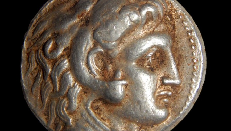 A coin from the period of Alexander the Great, part of a horde discovered hidden in a cave in northern Israel, February 2015. (photo credit: Samuel Magal/Israel Antiques Authority)