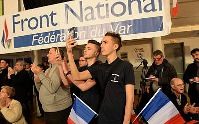 Supporters of the French far-right National Front party (FN) at local elections in La Valette du Var, on March 22, 2015 (photo credit: AFP/Boris Horovat)
