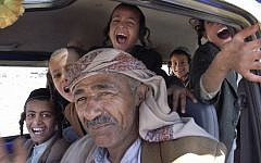 In this photo taken on April 8, 2009, Jewish Yemeni boys sit behind the driver of a minibus as they travel back to the town of Raydah, after a morning of Hebrew classes in the nearby village of Kharif, Yemen photo credit: AP/Hamza Hendawi