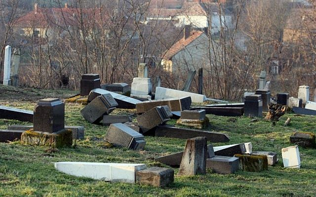Gravestones lie turned over in the Jewish cemetery in Marcali, 177 kms southwest of Budapest, Hungary, Friday, Jan. 28, 2011 after 75 graves have been violated. (Photo credit: AP/MTI, Gyoergy Varga)