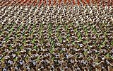 Members of Iran's Revolutionary Guards at an annual military parade in front of the mausoleum of the late Ayatollah Khomeini just outside Tehran, Iran, on September 22, 2014. (AP/Ebrahim Noroozi/File)