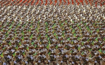Members of Iran's Revolutionary Guard Corps are seen at an annual military parade in front of the mausoleum of the late Ayatollah Khomeini just outside Tehran on September 22, 2014. (AP/Ebrahim Noroozi/File)
