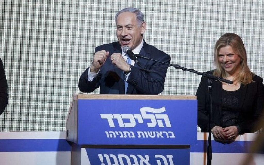 A victorious Prime Minister Benjamin Netanyahu greets supporters at the party's election headquarters In Tel Aviv. early on Wednesday, March 18, 2015. (photo credit: AP Photo/Dan Balilty)