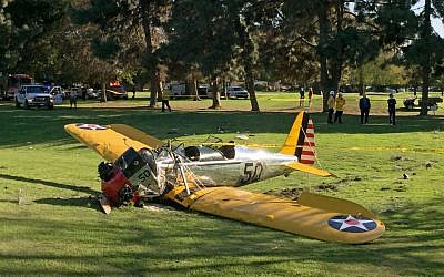 Harrison Ford's plane lies where it crash-landed on Penmar Golf Course in the Venice area of Los Angeles on Thursday, March 5, 2015. (photo credit: AP Photo/Damian Dovarganes)