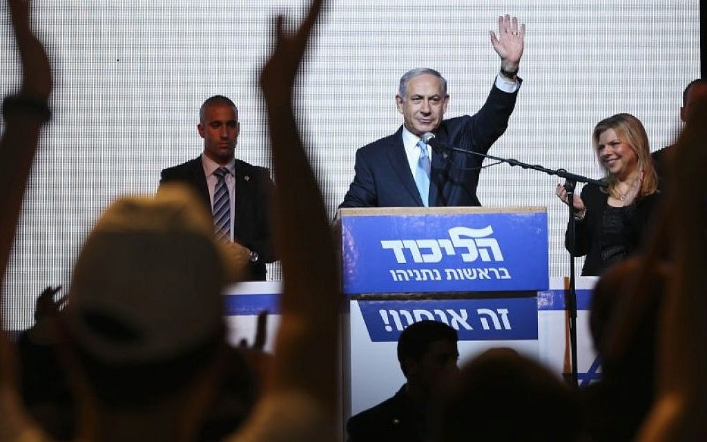 Prime Minister Benjamin Netanyahu greets supporters and hails victory at the Likud party's election headquarters in Tel Aviv, Tuesday, March 17, 2015. (AP Photo/Oded Balilty)