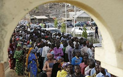 People displaced following attacks by Islamist militants lineup for accreditation before casting their votes, in Yola, Nigeria, Saturday March 28, 2015. (photo credit: AP Photo/Sunday Alamba)