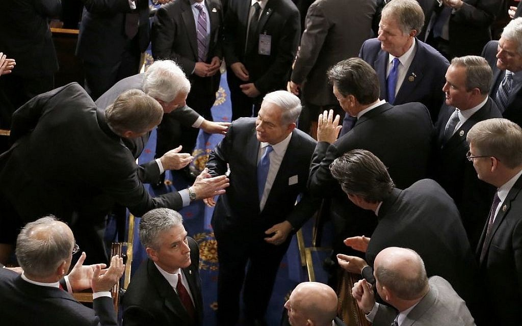 Prime Minister Benjamin Netanyahu shakes hands as he leaves the House chamber on Capitol Hill in Washington, Tuesday, March 3, 2015, after addressing a joint meeting of Congress in a speech opposing the imminent Iran nuclear deal . (AP/Andrew Harnik)