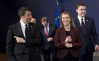Italian Prime Minister Matteo Renzi, left, speaks with European Union High Representative Federica Mogherini, second right, after a group photo at an EU summit in Brussels on Thursday, March 19, 2015. (photo credit: AP/Francois Mori)