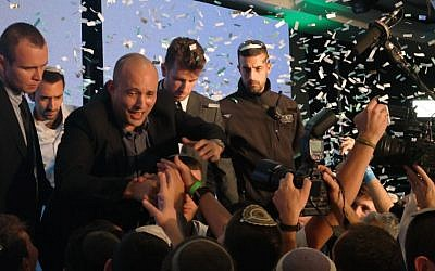 Jewish Home chairman Naftali Bennett celebrates with supporters, March 17, 2015. (Times of Israel/Avi Lewis)
