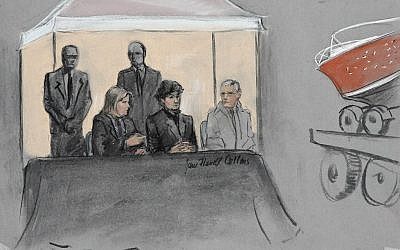 In this courtroom sketch, Dzhokhar Tsarnaev, center seated, is depicted between defense attorneys while the boat in which he was captured in sits on a trailer for observation during his federal death penalty trial, Monday, March 16, 2015, in Boston. Tsarnaev is charged with conspiring with his brother to place two bombs near the Boston Marathon finish line in April 2013, killing three and injuring more than 260 people. (photo credit: AP/Jane Flavell Collins)