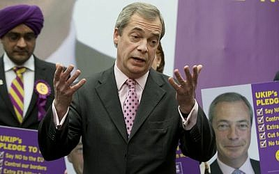 British lawmaker Nigel Farage talks to the media as he launches a poster campaign for the general election for his UKIP party in London Monday, March 30, 2015. The United Kingdom will go to the polls for a general election on May 7. (photo credit: AP/Alastair Grant)