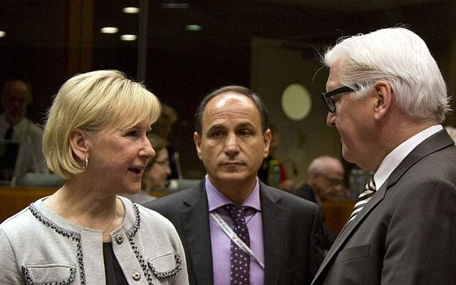Sweden's Foreign Minister Margot Wallström (left), speaks with German Foreign Minister Frank-Walter Steinmeier (right), during a meeting of EU foreign ministers at the EU Council building in Brussels on Monday, March 16, 2015. (photo credit: AP/Virginia Mayo)