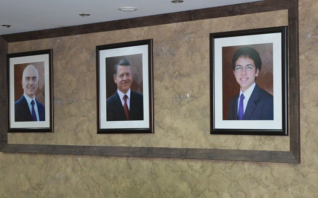 Images of the Jordanian royal family hang from the walls of the Center for Israel Studies, Amman, March 29, 2015 (photo credit: Avi Lewis/Times of Israel)