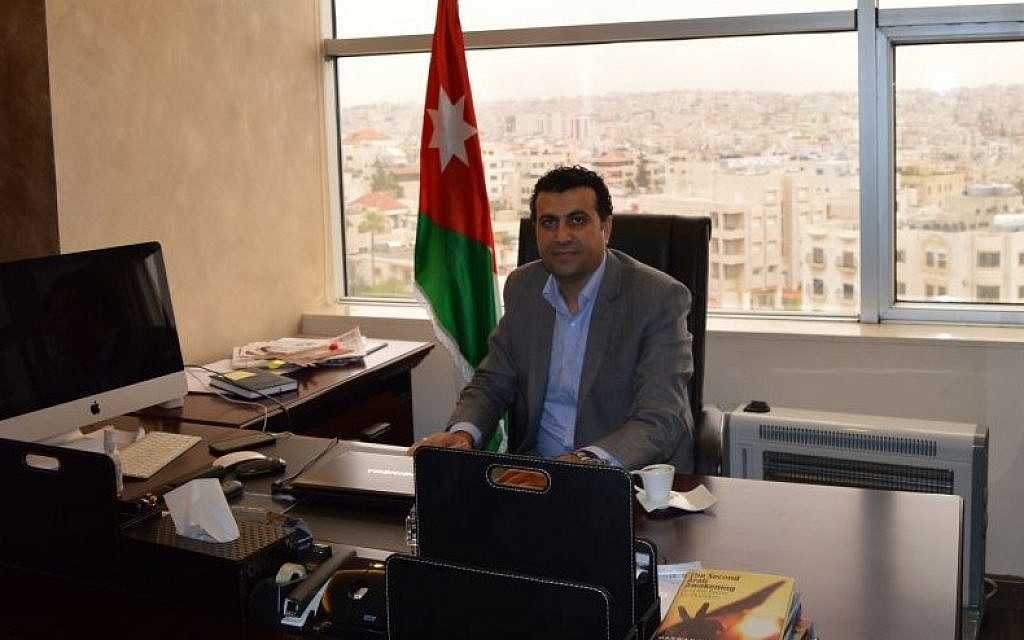 Dr. Abdullah Swalha at his desk at the Center for Israel Studies, Amman, March 29, 2015 (photo credit: Avi Lewis/Times of Israel, Benyamin Loudmer)