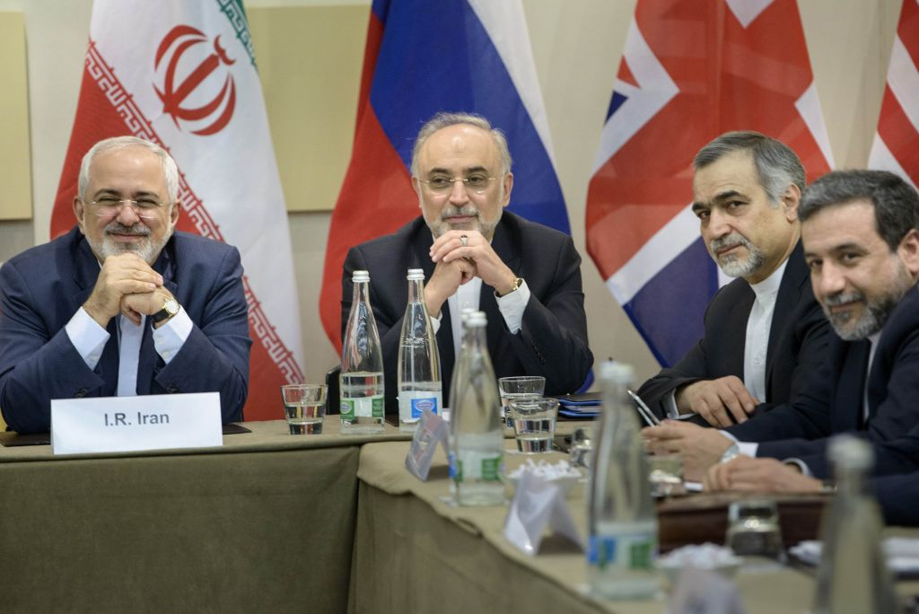 Iranian Foreign Minister Javad Zarif, left, Head of Iranian Atomic Energy Organization Ali Akbar Salehi, second left, Special Assistant to Iranian president Hossein Fereydoun, second right, and Iranian Deputy Foreign Minister Abbas Araghchi wait for the start of a meeting with Britain, Russia, China, France, Germany, European Union and the U.S. officials at the Beau Rivage Palace Hotel in Lausanne, Switzerland Monday, March 30, 2015, during Iran nuclear talks (AP Photo/Brendan Smialowski, Pool)