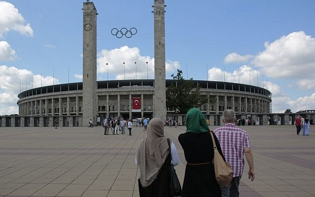 Turkish people arrive at the Olympic Stadium in Berlin, Germany, to cast their vote for the Turkish presidential election in July 2014 (photo credit: AP/Markus Schreiber)