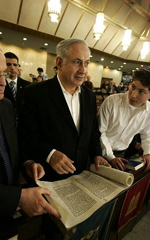 Netanyahu with a scroll of the Book of Esther on March 10, 2009 in Jerusalem's Great Synagogue (photo credit: Uri Lenz/ Flash 90)
