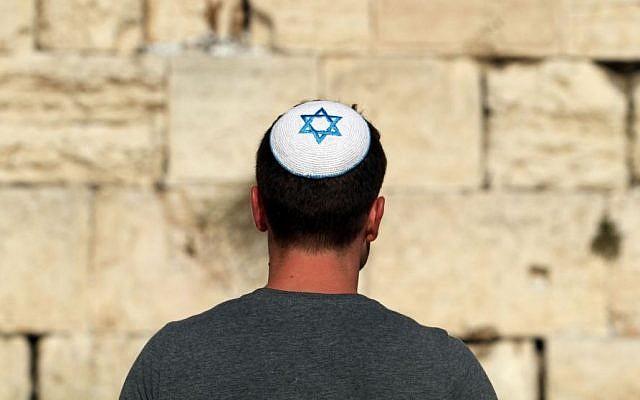 Illustrative: An Israeli man with a yarmulke- kippa featuring a Star of David at the Western Wall in Jerusalem, September 10, 2012. (photo credit: Yoav Ari Dudkevitch /Flash90)