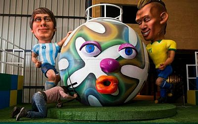 Getting ready for Holon's Adloyada parade with a float depicting Argentine soccer player Lionel Messi (L) and Brazilian player Neymar (R) at a set design factory near Kfar Saba (photo credit: Yonatan Sindel/Flash 90)